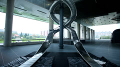 Big steel slide in the middle of museum of contemporary art in Zagreb, Croatia Stock Footage