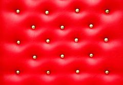 Red leather pattern with knobs,texture for background Stock Photos