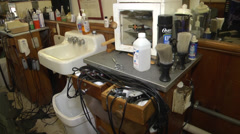 Barber shop drawers pan to wide shot Stock Footage