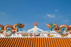 Chinese dragon and the blue sky in shrine,east of thailand Stock Photos