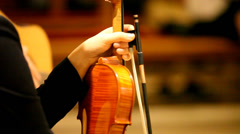 Young brunette musician holding her precious violin Stock Footage