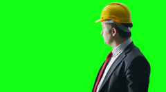 Portrait of businessman wearing a hard hat on green screen background. Stock Footage