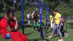 Playground with special kids swings Stock Footage