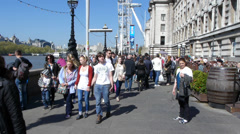 Tourists walking on the South Bank Promenade in London Stock Footage