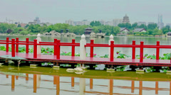 Bridge on lake in chinese park , xi'an, shaanxi, China Stock Footage