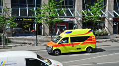 Ambulance vehicle drives trough the Neue Mitte in Jena, Germany Stock Footage