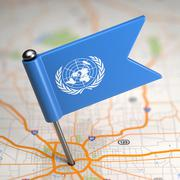 United Nations Small Flag on a Map Background. Stock Illustration