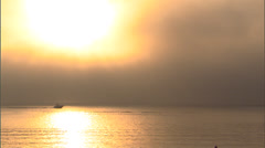 Powerboat and foggy sunrise Stock Footage