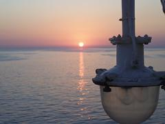 sunset on a ferry - stock photo