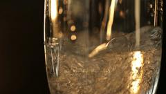 Champagne Pours in a Wineglass Stock Footage