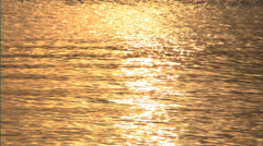 Early summer sunrise reflecting on water Stock Footage