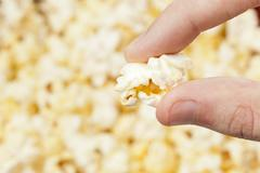 crunchy white buttered popcorn - stock photo