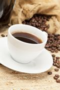 black coffee with coffee beans - stock photo