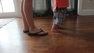 Stock Video Footage of mother helps child with first steps