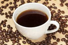 Black coffee with coffee beans Stock Photos
