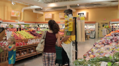 young family shops in grocery store - stock footage
