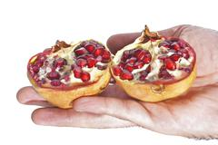 Fresh pomegranate in hand Stock Photos