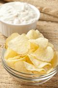 Stock Photo of fresh potato chips with ranch dip