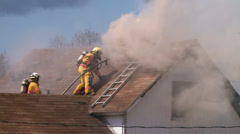 Firefighter Climbs Roof - stock footage