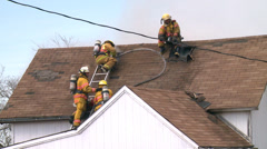 Firefighters Attic Fire Stock Footage