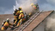 Stock Video Footage of Firefighters Fighting Attic Fire