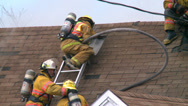 Stock Video Footage of Firefighter Sprays Water into Attic