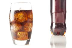 refreshing brown soda with ice - stock photo