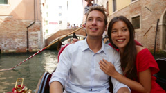 Tourists travel couple in Venice on Gondole boat Stock Footage