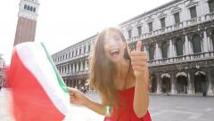 Woman waving Italian flag happy in Venice, Italy Stock Footage