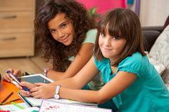Teenagers doing homework at home. - stock photo