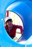 smiling little boy in a baseball cap - stock photo