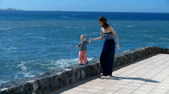 HD1080p50 Mother with sunglasses  and young boy standing on the seashore. Part 3 Stock Footage
