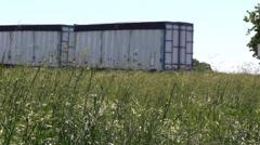Big rig semi trucks, interstate 5, onramp Stock Footage
