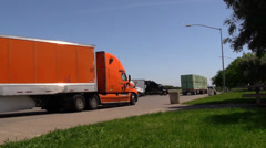 Big rig semi trucks, interstate 5 ,orange truck Stock Footage