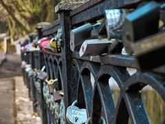 HDR photo of Locks on the bridge railing - stock photo