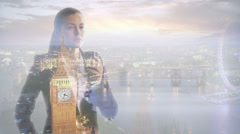 Businesswoman drinking coffee with visual background the city of London.  Stock Footage