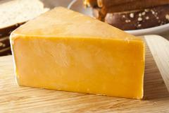 Traditional yellow cheddar cheese Stock Photos