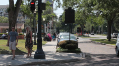 Young caucasion couple comes to street corner and waits for crossing light Stock Footage