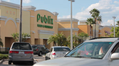 Car Passes in Front of Publix Grocery store Stock Footage