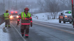 Car crash and rescue in winter snow storm Stock Footage