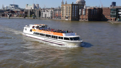 Passenger cruise boat on the River Thames in London Stock Footage