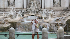Tourists taking photo selfie, Rome, Trevi Fountain - stock footage