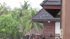 Rain  down on  tropical beach resort. - stock footage