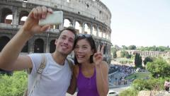 Happy travel couple taking selfie, Coliseum, Rome Stock Footage