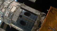 Hubble Space Telescope lifted out of the payload bay of Space Shuttle, 4K Stock Footage