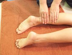 Reflexology leg massage,thai traditional massage,thailand. Stock Photos