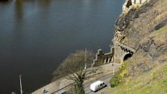 Entrance to the tunnel with the river and cars Stock Footage