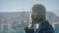 Businessman engaged in a phone call with visual background of New York city Stock Footage