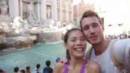 Tourist couple taking selfie, Rome, Trevi Fountain Stock Footage
