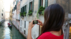 Woman tourist taking picture photo in Venice Italy - stock footage
